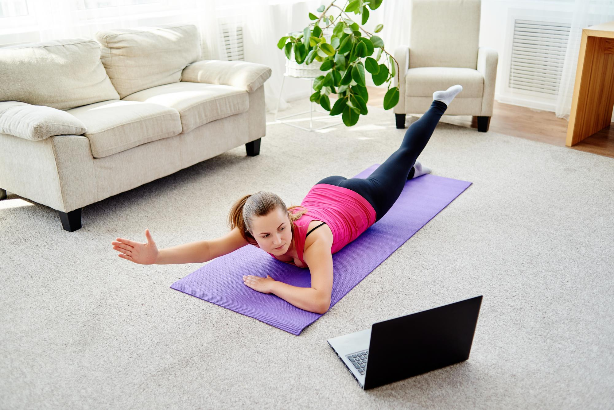 Woman doing exercises to prevent lower back pain when working from home