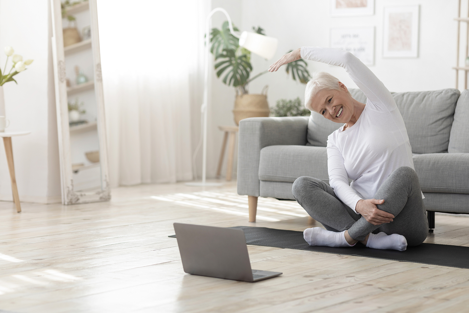 Woman doing pilates exercise at home