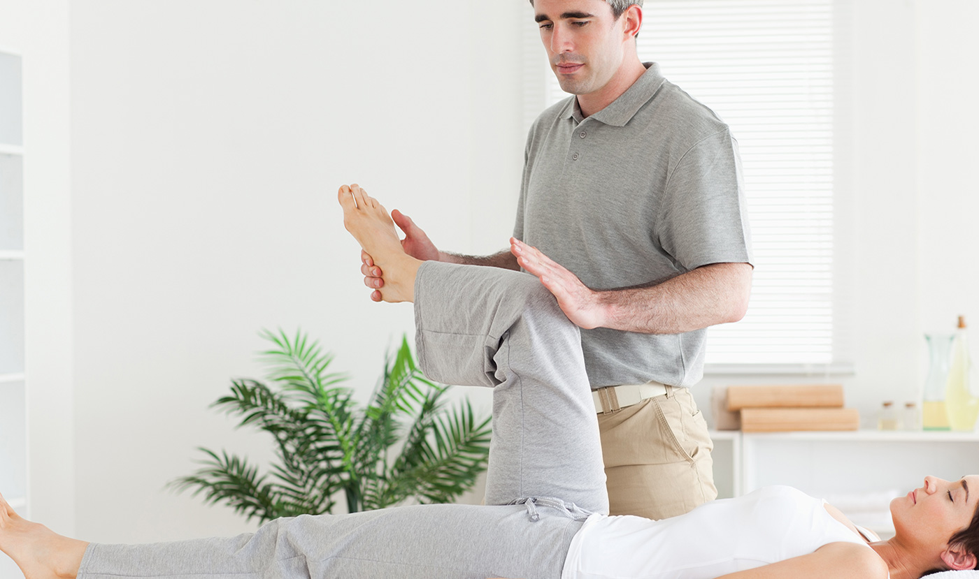 Physiotherapist treating a woman with knee pain in London, Ontario